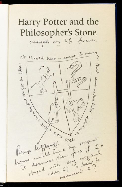yabookreviewer:  Sneak Peek At J.K. Rowling's Annotated 'Philosopher's Stone' Earlier this month it was announced that J.K. Rowling was placing a first edition annotated copy of Harry Potter and the Philosopher's Stone up for auction. New photos of the book released today depict some amazing notes written by the author within her debut novel. The Guardian shared three pages from inside this extremely rare charity item. In addition to the new notes, we also see a sketch of baby Harry in his carriage sitting out front Number Four Privet Drive. Check out the images, and annotations right here on Young Adult Book Reviewer