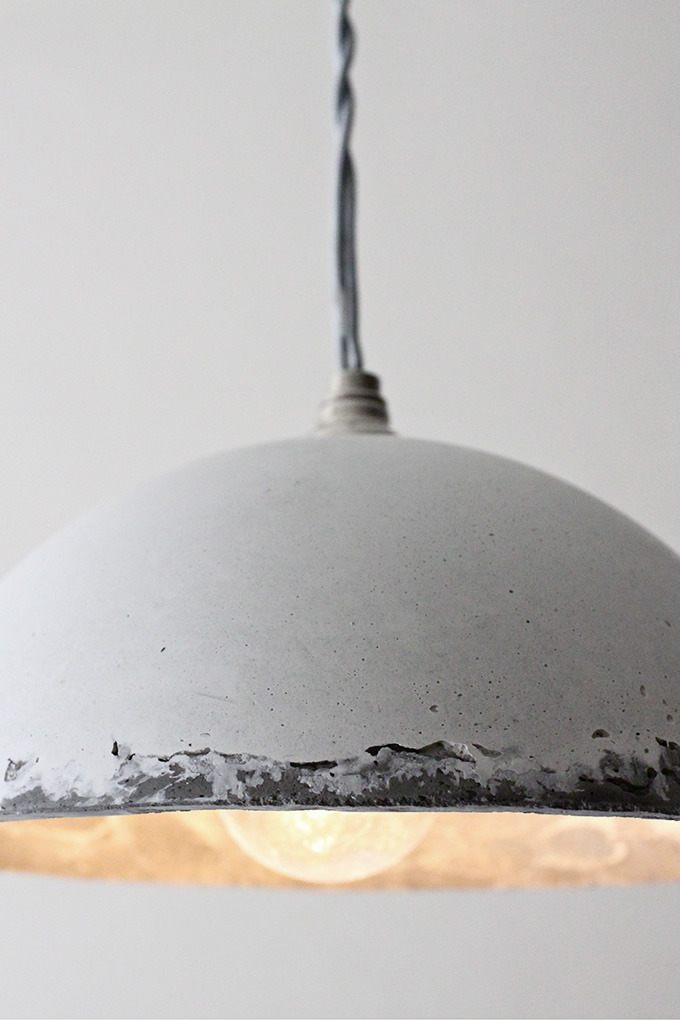 lifeonsundays:  Round Pendant This pendant light balances several material elements. The smooth cascading concrete shade is engineered perfectly to fit with the polished nickel fixture. The silver threaded 10' cord adds a vintage flair to this modern ensemble.