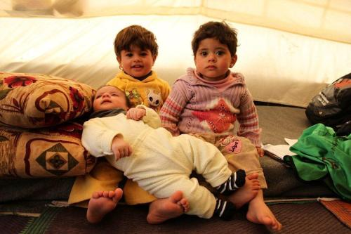 unicef:  Birth in a Refugee CampBabies are born almost every day in Za'atari refugee camp in Jordan. Saqer, pictured with his older brother and sister, is one of them. His mother did not want to leave Syria but the bombs forced her when she was 7 months pregnant. Now we're helping her, and expectant mothers like her, cope.  Learn how http://www.unicef.org/infobycountry/jordan_68014.html © UNICEF Jordan/2013/Masciarelli