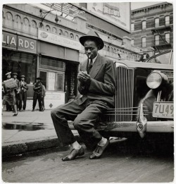 Satchel Paige waiting for pool hall adversary, Harlem, New York, 1941, by George Strock