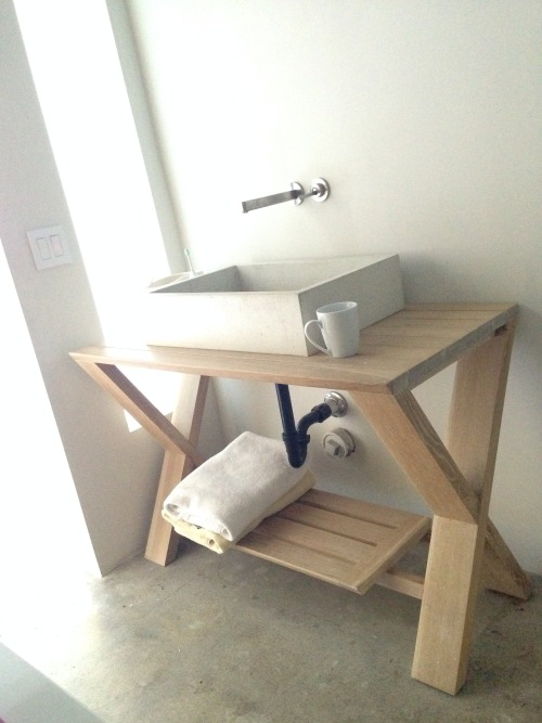 awelltraveledwoman:  10fld:  A couple years ago while remodeling our home I designed and built this concrete sink and wood table. The idea of not having a mirror to look into was an experiment to bring one into the present. It eliminates the idea that the self is externally composed; removing the image of self allowing one to truly be in many senses of the word. We can be present without the pull of expectation, and remove any other illusory demands upon self. What is it that we really need to be? So many illusions are placed in front of us: TV, movies, magazines, phones, and then we are left with a mirror for reflection. I'd say all these including the mirror are illusions we feed into. To truly be ones self one must feel from within the happenings if their environment. To do this is to become one with your surroundings rather than separate from them.  ^