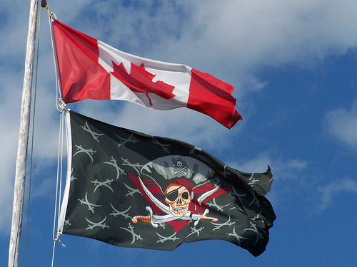 "Are Canadians About to Be Prosecuted for File Sharing? As of late, a company named Canipre has been drumming up a lot of shadily defined fear mongering against""one million Canadians"" who they insist are illegally downloading copyrighted material. If you have never heard of Canipre, they're a new company that's looking for record label and film studio clients they can work with to suck the cash out of Canadian citizens. Canipre has teamed up with two god-awful movie studios to begin their noble journey. The first is Voltage Pictures, who has released a ton of movies that are barely bargain bin worthy, plus a film you may know called The Hurt Locker. Canipre's other companion in this shakedown mission is NGN Productions, who has released such gems as Paparazzi Princess: The Paris Hilton Story, a made-for-TV program, and Recoil, an action movie with Stone Cold Steve Austin. Not only is it bullshit that Stone Cold Steve Austin has been dragged into this mess, the tactics behind Canipre's lawsuits seem to be bullshit as well. On Canipre's website, they proudly advertise to potential clients that ""when asked, 95%"" of accused file-sharers ""stop"" downloading entirely. Evidently, they like to brag about their bullying tactics. Their front page also has a randomly generating slogan that spouts out wisdom like, ""it's an arms race, and your bottom line is the target,"" ""your audience isn't rational,"" and ""if they keep thinking it's free, when do you go out of business?"" A screenshot from Canipre's friendly website.As for Canada's copyright laws, a close reading of the penalties detailed in our new amendment to the copyright act, C-11, leads to some uncertainties. For example, if you are found guilty of ""circumventing"" a ""technological protection measure"" you can be fined up to $25,000 or sentenced to a maximum of sixth months in jail. Would that include breaking the iTunes DRM off an album that someone purchased, then sending that newly ""unprotected"" digital copy to a friend? Continue"