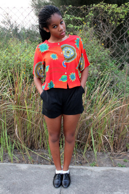 Zoe A. of Nigeria is one of our best dressed readers. Her bright printed top screams summer. What do you think of her look?