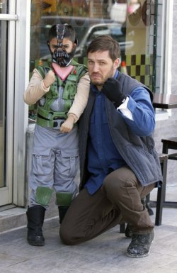 Tom Hardy with a young fan dressed as his evil character Bane from The Dark Knight Rises. The two posed for pictures on Tuesday while Tom took a break from filming Animal Rescue in New York City.