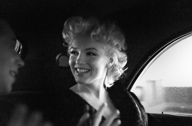 Backseat Talker In this undated image, Monroe chats with Dick Shepherd in the back of a cab in New York City.