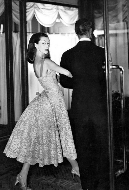 theniftyfifties:  Dovima wearing a lace gown by Jean Patou at Maxim's, Paris, August 1955. Photo by Richard Avedon.
