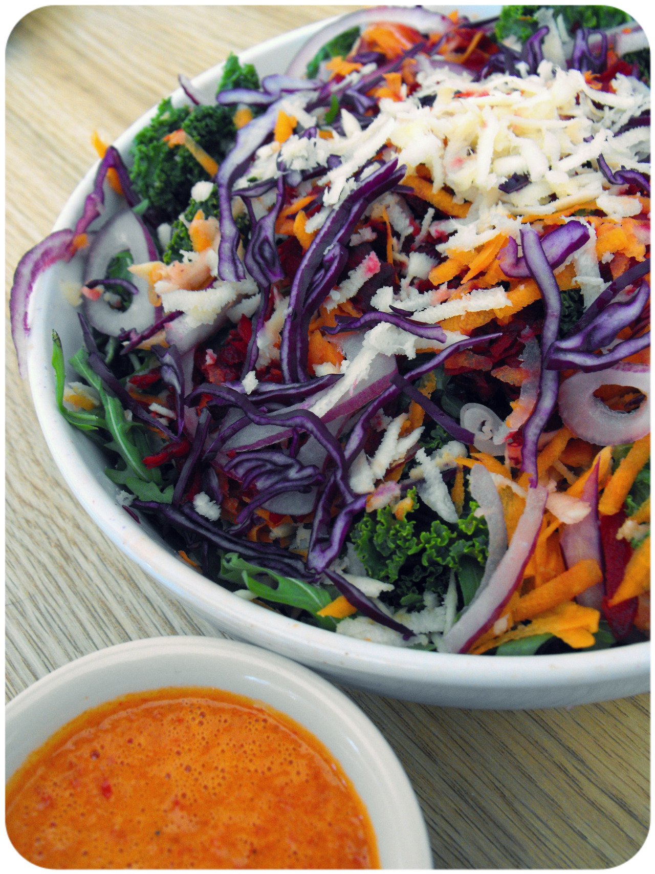findvegan:  Kale rainbow salad with orange red pepper dressing.