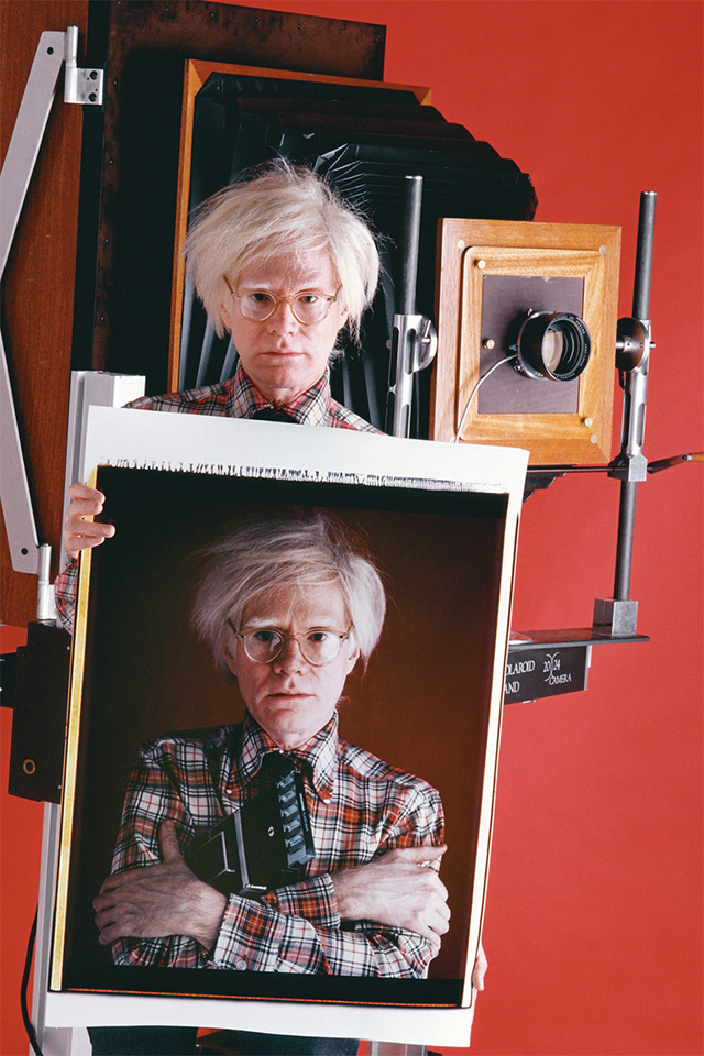 (via vintage everyday: Andy Warhol holding a Polaroid of Andy Warhol, 1980)