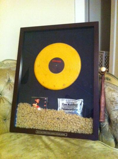 Velveeta awards Tim Kasher a gold record made of cheese for Cursive's Domestica.