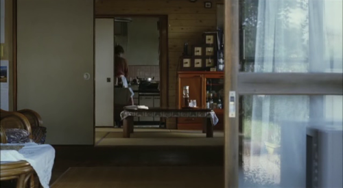 The image of Yoko's stepmother working in the kitchen, tightly framed by multiple doorways, highlights the constricting conventional role of a homemaker that Yoko, by choosing to have her child out of wedlock, yearns to reject, and a scene in which the two women have to borrow sake and glasses from Yoko's next-door neighbor—a request that makes the stepmother, but not Yoko, feel ashamed—elucidates the widening generational gap between the girl and her parents. For Hou, the past and present are constantly engaged in a tug-of-war, and the director captures the oppressive, inexorable march of time weighing down upon Yoko and her friend—a bookstore owner named Hajime (Tadanobu Asano, star of Takashi Miike's Ichi the Killer)—through a series of stunning sequences: Yoko's dream about a child's face turning first wrinkly and then to ice (a nightmare of impending maternity begat by her long-ago reading of Maurice Sendak's Outside Over There); the vision of a pocket watch set against the front windshield of a moving train; and a computer's digital clock screensaver seen at the train station Yoko used to depart from as a young student. In the same vein, Hajime's computer-generated artwork, featuring a fetal version of himself encased in a womb of locomotives, visualizes the inescapable omnipresence of time's progression, and the young man's hobby of dutifully recording train noises—an attempt to sonically capture the essence of life in motion—ultimately becomes an understated metaphor for Hou's tender, observant, contemplative cinema. Café Lumière