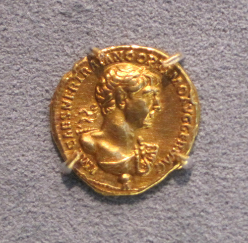 Gold coin, Aureus, from ancient Rome with bust of Trajan, the only Roman Emperor to conquer Southern Mesopotamia and Babylonia and turn them into Roman provinces. The coin dates back to 114-117 CE. Boston Museum of Fine Arts, Boston, MA.     Photo by Babylon Chronicle