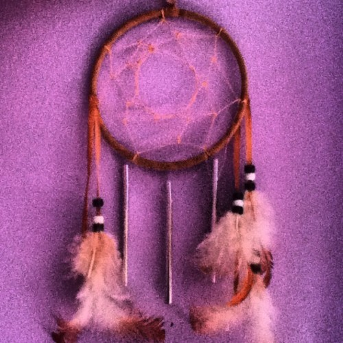 My dream catcher from a Native American school #dreamcatcher #nativeamerican #feathers #pretty #beads #chimes