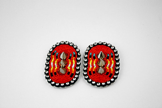 littleangrytiger:  kaivaviich:  fyeahindigenousfashion:  red spike earrings, Eleumne (Ojibwe)  NO I need these omg   oh my fuck these are too good  badass