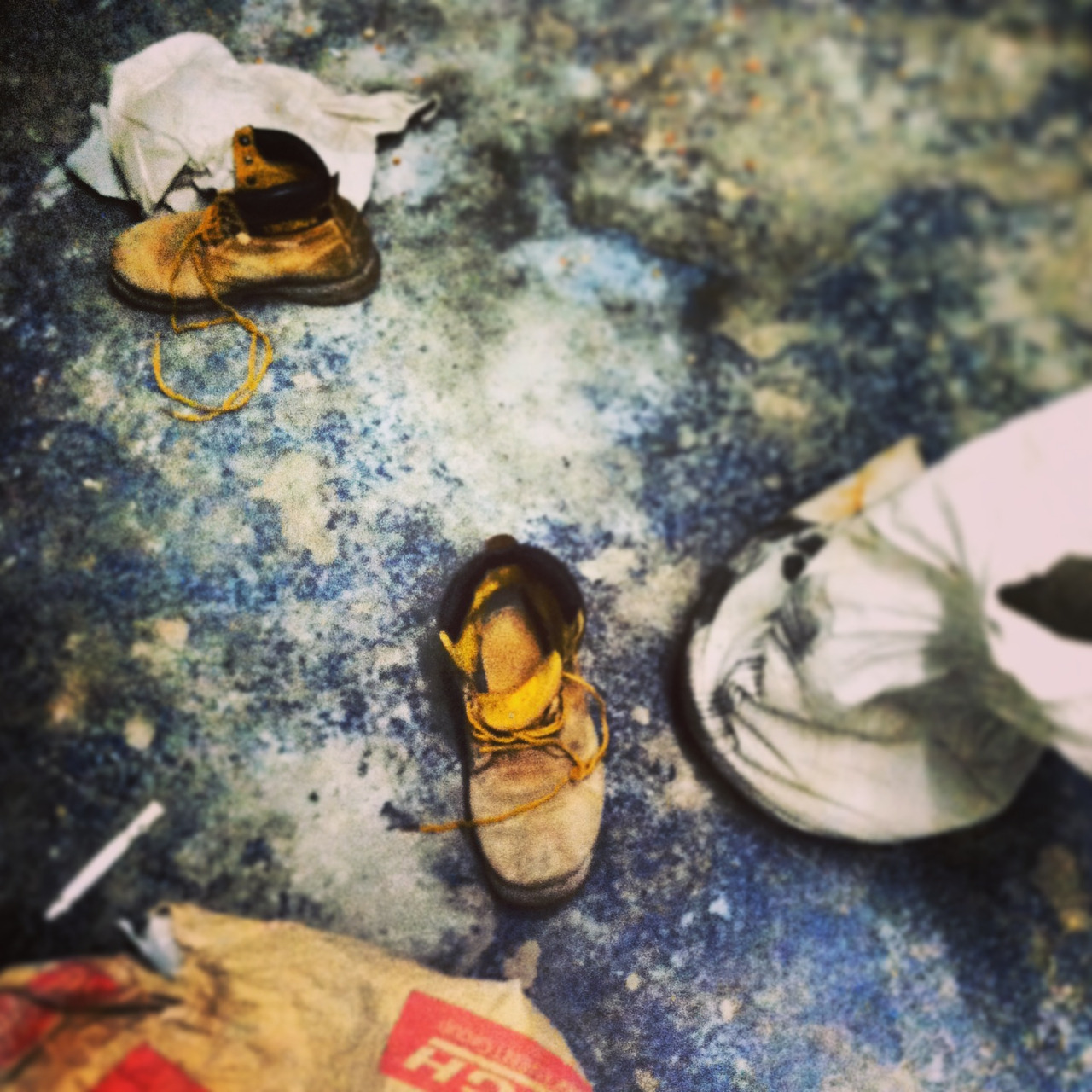 Location: Long Island City, New York Abandoned shoes at construction site