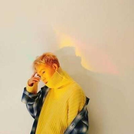 260196:  Here is Jonghyun, playing the kazoo