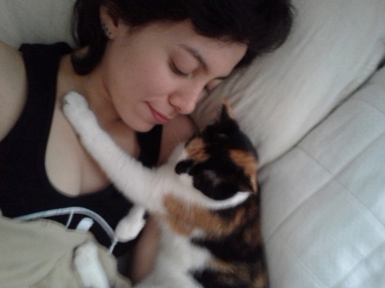 My cat likes hugging. She was trying to spoon or be spooned here.