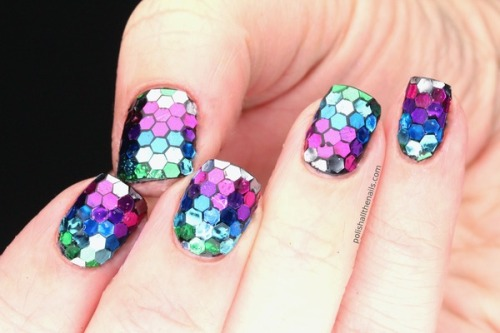 Laura T. hand-placed large hex glitter for these amazing  Rainbow Fish Nails!