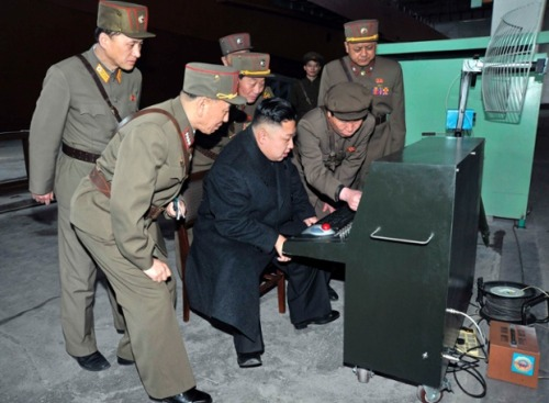 North Korean leader Kim Jong-un looks at the latest combat and technical equipment of the Korean People's Army in an undisclosed location. Photograph: KCNA/Reuters  Looks like the equipment an evil genius would use in a 1960s James Bond film with Sean Connery was still in the role.