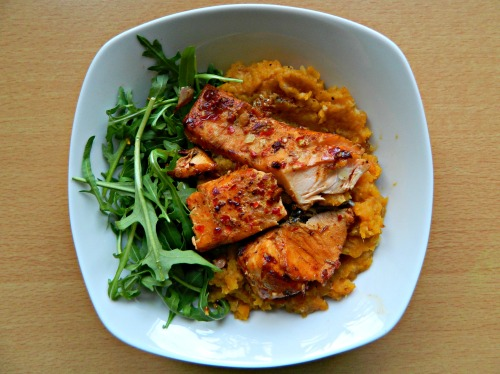 seedsnsmiles:  Sweet chilli and soy salmon with spicy sweet potato and red lentil mash and rocket. I honestly thought fish didn't make a difference to my skin, but since coming off my medication, I've found it has a really significant impact on my acne, so yup, I'm probably going to have fish once or twice a fortnight until my face decides to stop hating me again. Flaxseed and walnuts just didn't do it for me, unfortunately. :/