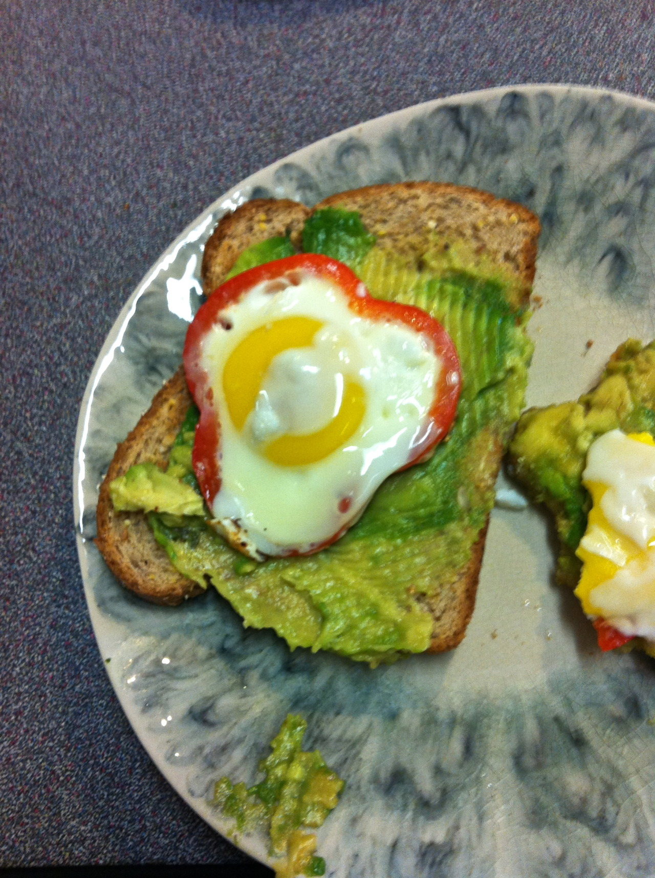toast with avocado and fried egg in pepper ring. best breakfast ever.