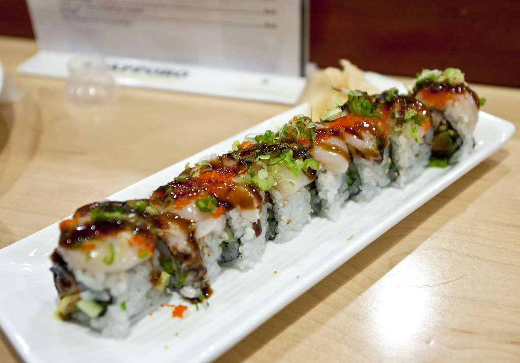 f-word:  marilyn mon-roll: crab & avocado roll topped with raw scallops, sweet soy, tobiko, and green onions photo by nicknamemiket