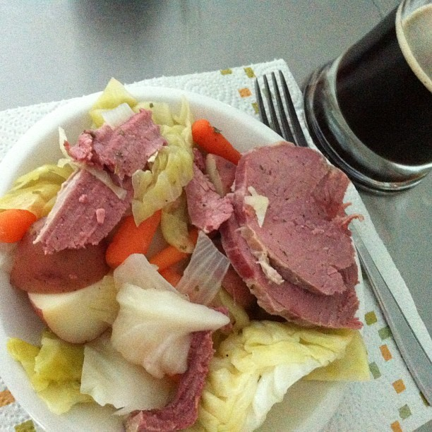 Yesterday's St. Patty's Day feast…complete with Guinness.  💚🍀 #cornedbeef #cabbage #carrots #redpotato #roast #low and #slow #instagood #homemade #kitchen #food #carrot #meat #carnivore #beer #mug #dinner #mmm (at www.inthekitchenwithkristin.com)