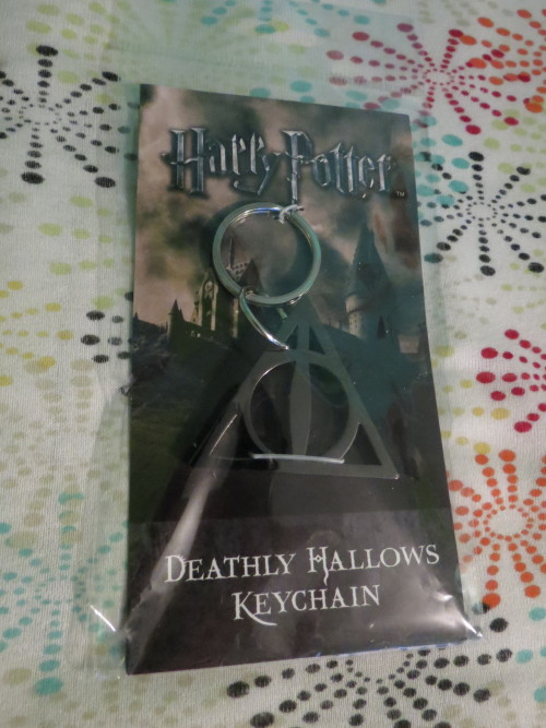 New key chain :) the Deathly Hallows I want that as a tattoo so bad it's not even funny! Gift from 22nd Birthday yesterday!