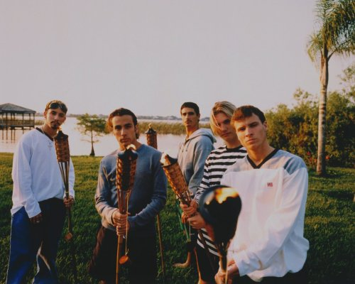 backstreetboys:  Today's BSB 20 Countdown photo is from 1998! Who knew we could make tiki torches look so good? ;)