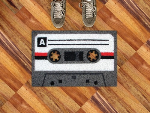 hoveringcat:  This cassette tape doormat from Meninos is far too lovely to wipe muddy feet on.