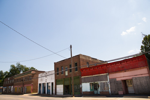 Old, sad, empty buildings line a street in Poplar Bluff, MO.