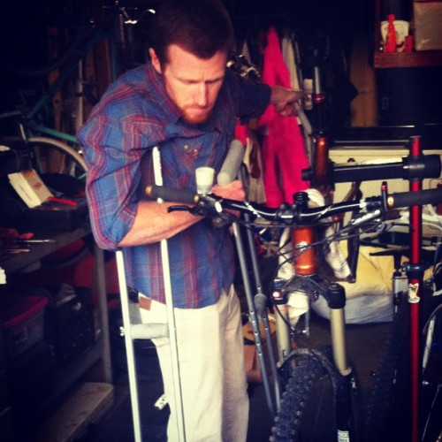 The world's best bike mechanic doesn't let something like a fractured patella stop him from bleeding my breaks #bikelove