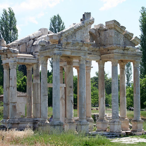 Tetrapylon; The Arched Gate of Aphrodisias The tetrapylon (Four Gates) is so called as it is made up of four groups of four columns. It served as a ceremonial gateway.The gate is adorned with reliefs of Nike, Eros, animal figures and carved acanthus leaves. Follow the link to see all my The Tetrapylon gifts and collectables.Click the links to see all of my Redbubble Aphrodisias Paintings,Aphrodisias Photography, Aphrodisias Greeting Cards, Aphrodisias Stickers, Aphrodisias Tees,, Aphrodisias iPhone Cases and Aphrodisias iPads.    -——————————————————————————————————————————————————      *My Images Do Not Belong To The Public Domain. All images are copyright © taiche. All Rights Reserved. Copying, altering, displaying or redistribution of any of these images without written permission from the artist is strictly prohibited