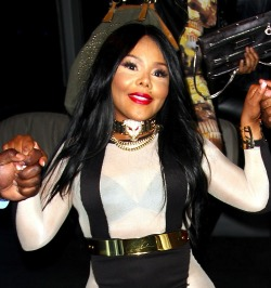 buzzfeedceleb:  We need to talk about Lil Kim's face.  Who is that??????