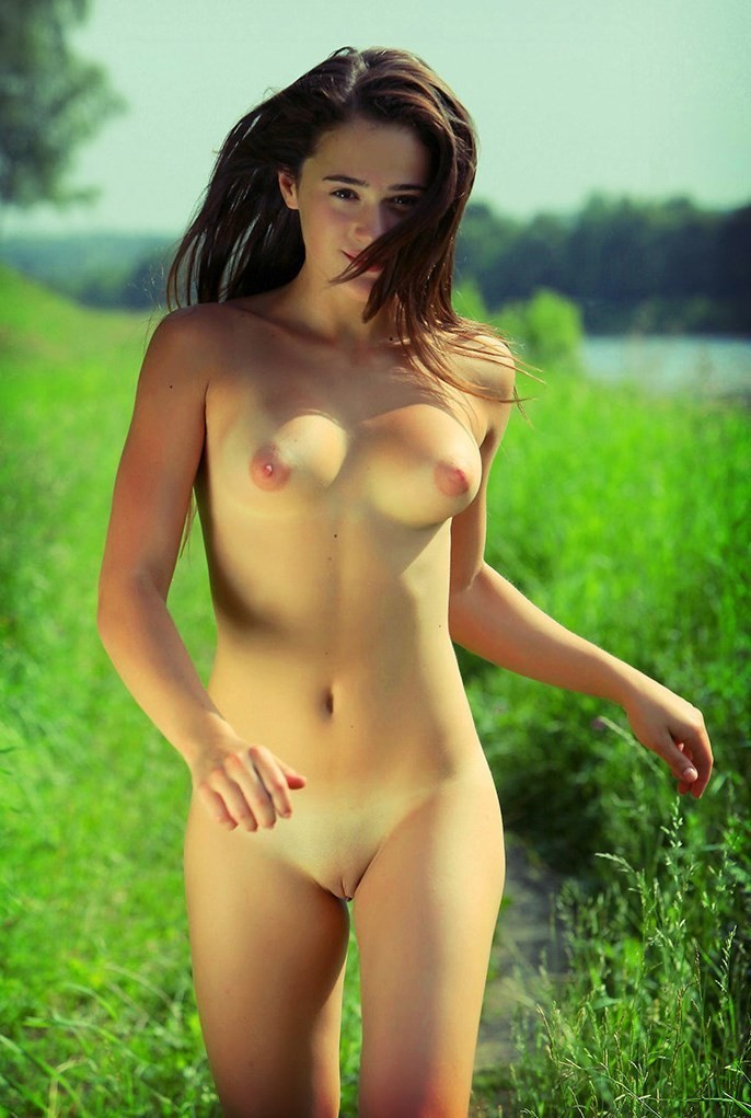 Naked girl on grass