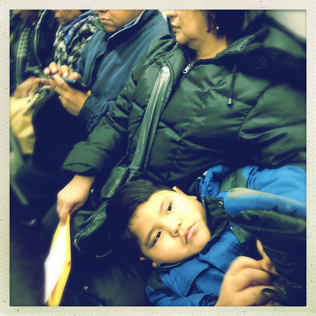 relaxing. on Flickr.A kid relaxes on the 7 train.