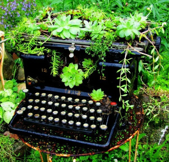 """Gardening with repurposed objects,"" continued:  Old typewriters can be useful as new planters. (photo via Charmers)"