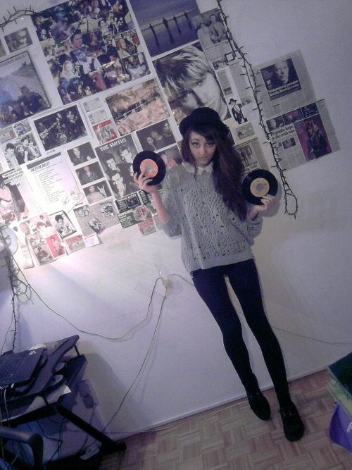 city-of-bugs:  i'm supossed to be studying history but i'm posing with vinyls instead