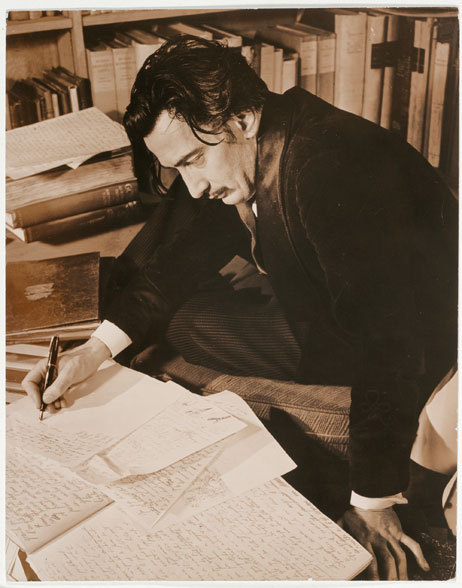 "awesomepeoplereading:  Dali reads and writes. nevver:  ""The first man to compare the cheeks of a young woman to a rose was obviously a poet; the first to repeat it was possibly an idiot.""  ― Salvador Dalí"