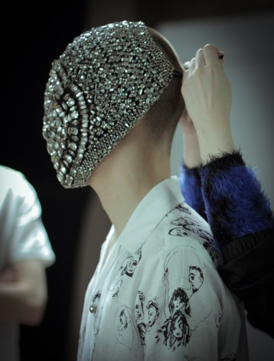 garcode:  Phillip Ellis wears clear crystal mask by Margiela SS/13 and black & white illustrated shirt by Claire Barrow for Primal Scream video clip. via