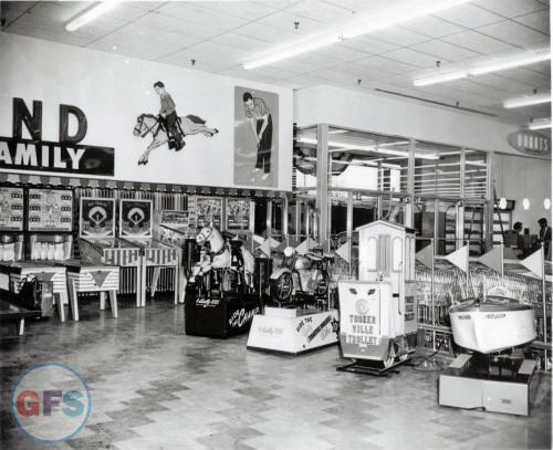 Children's arcade/play area at an unknown Two Guys location, 1952.