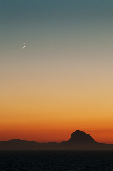 inhibitor:  Crescent Moon over the Cabo de Gato (by tramsteer)