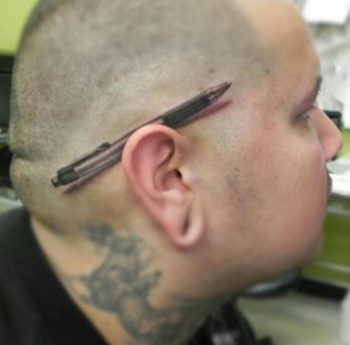 Hyper Realistic Pen Behind Ear Tattoo That's some pretty badass ink ink.