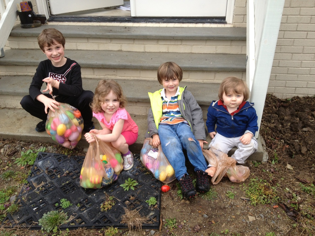Easter egg hunt. Here's Noah and Jonah with their cousins. It was a little rainy on easter. The rain didn't slow them down at all. The older kids were nice enough to pass over the few eggs put by the door so Jonah could enjoy the egg hunt too.