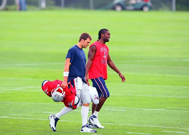 Tom Brady and Randy Moss walk off the field together after a August 2008 training camp practice. (Damian Strohmeyer/SI) GALLERY: Classic Photos of the New England Patriots
