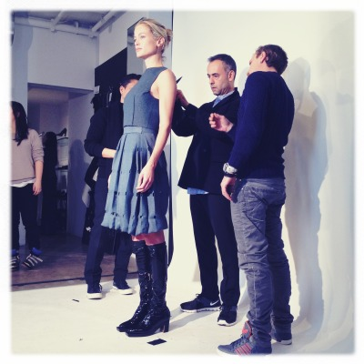 Carolyn Murphy being fitted by Francisco and his team the night before the show.