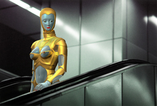 """e"" in Thierry Mugler's Sexy Robot Outfit, Vienna, by Claudia Hart (2003) lambda print, mounted on black cyntra  30 x 48""  /  76.2 x 121.9 cm"