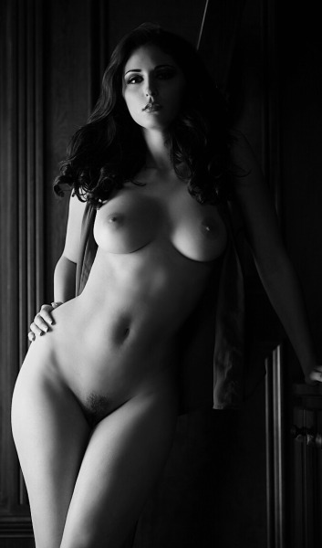 Nude brunette in black and white