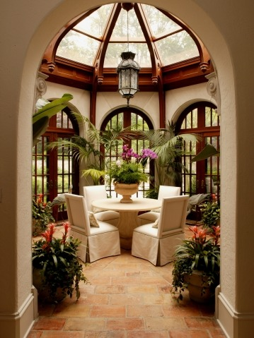 Octagonal sunroom with hand-carved trusses and finials from Harrison Design Associates Projects. This is a dream