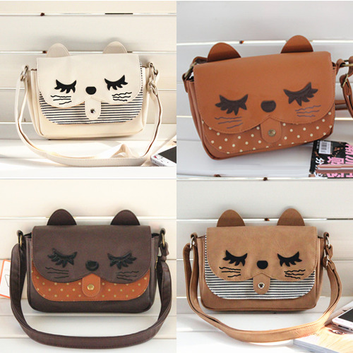 shop-cute:  Sleepy Cat Messenger Bag (Choose Color) $24.00 Use the code PASTELCUTIE at checkout for 10% off! ♥
