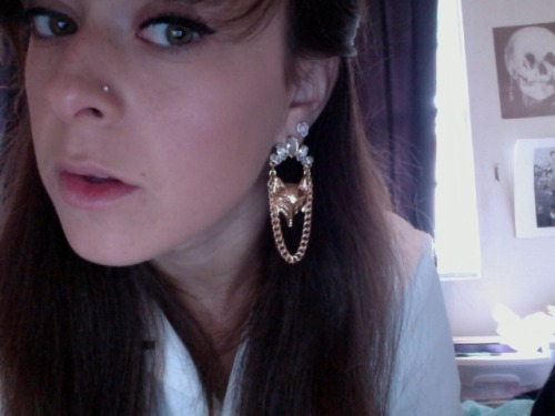 sorry for this being so close to my face but check out my new earrings. they're foxes and i'm in love with them.